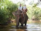 Joe and ManLan on an elephant